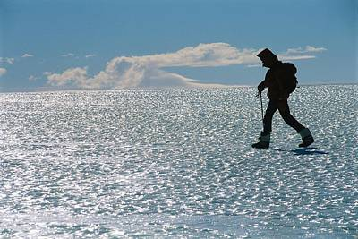 Patriot Hills Photograph - A Hiker Traverses Bare Glacial Ice by Gordon Wiltsie