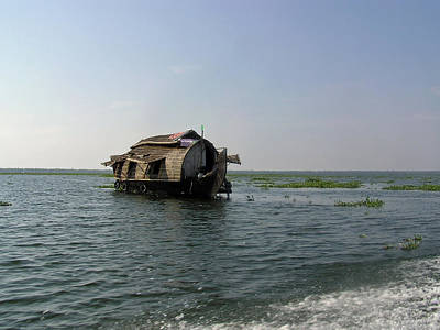A Houseboat Moving Placidly Through A Coastal Lagoon In Alleppey Art Print by Ashish Agarwal