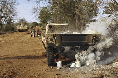 Photograph - A Humvee Burns After A Simulated by Stocktrek Images