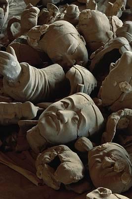 A Jumbled Heap Of Terra-cotta Heads Art Print by O. Louis Mazzatenta