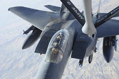 A Kc-135 Stratotanker Refuels An F-15e Art Print by Stocktrek Images