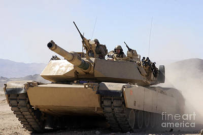 Photograph - A Kid Enjoys A Cruise In An M1a1 Abrams by Stocktrek Images