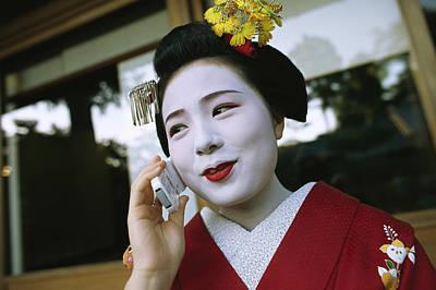 A Kimono-clad Geisha Talks On A Cell Art Print by Justin Guariglia