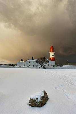 A Lighthouse And Building In Winter Art Print by John Short
