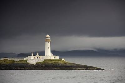 The Sea Of Tranquility Photograph - A Lighthouse Eilean Musdile In The by John Short