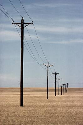 A Line Of Telephone Poles Travels Art Print by George Grall