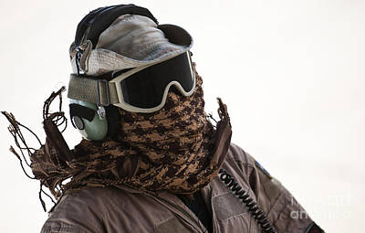 Obscured Face Photograph - A Loadmaster Protects His Head by Stocktrek Images