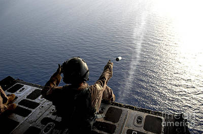 World Forgotten - A Loadmaster Throws A Smoke Grenade by Stocktrek Images