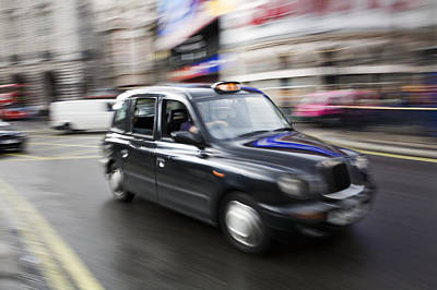 Livelihood Photograph - A London Cab Traveling Through Traffic by Justin Guariglia