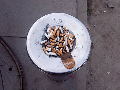 A Lot Of Cigarettes Stubbed Out At A Garbage Bin Art Print by Ashish Agarwal