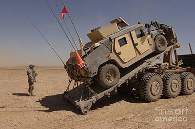 A M1114 Armored Vehicle Is Unloaded Art Print by Stocktrek Images