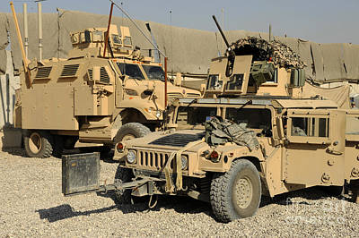 A M1114 Humvee Sits Parked In Front Art Print by Stocktrek Images