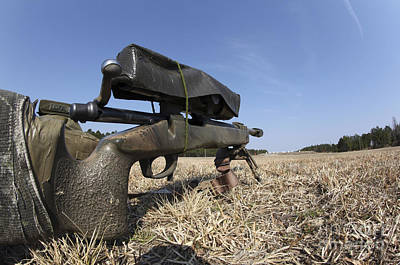 A M40a3 7.62mm Sniper Rifle Sits Ready Art Print by Stocktrek Images