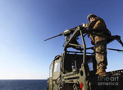 A Machine Gunner Mounts A M-2 Print by Stocktrek Images