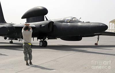 A Maintenance Airman Guides A Pilot Print by Stocktrek Images