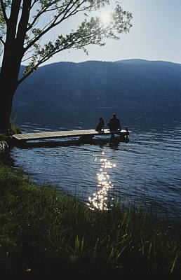 Etc. Photograph - A Man And His Dog On A Lake Skaha Dock by Mark Cosslett