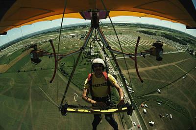 A Man Flies In A Hang Glider Powered Print by James A. Sugar