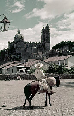 A Man On Horseback Looks At The Borda Art Print by Luis Marden