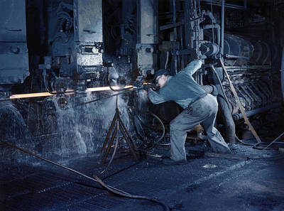 Youngstown Ohio Photograph - A Man Operates A Machine Rolling Flat by Willard R. Culver