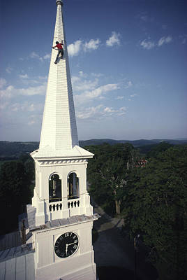 Of Painter Photograph - A Man Paints The Steeple Of A Vermont by Michael Melford