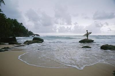 A Man Stands With A Surfboard Art Print