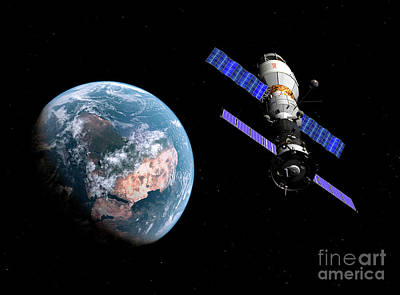 A Manned Soyuz Tma-m Spacecraft Docked Art Print by Walter Myers