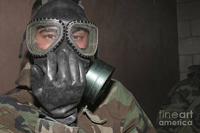 Torn Clothing Photograph - A Marine Clears His Gas Mask by Stocktrek Images