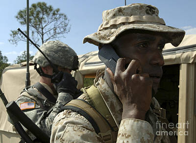 Talking On The Phone Photograph - A Marine Communicates With Aircraft by Stocktrek Images