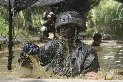 A Marine Splashes As He Makes His Way Art Print by Stocktrek Images