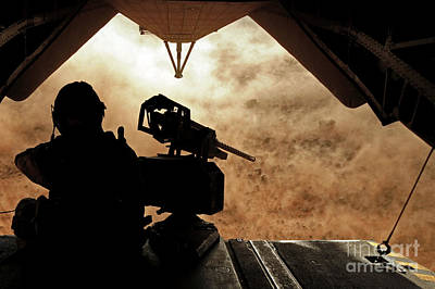 A Marine Waits For Dust To Clear While Art Print by Stocktrek Images