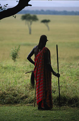 A Masai Warrior With A Spear Looking Art Print by Michael Melford