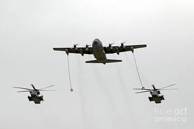 A Mc-130w Conducts An In-flight Art Print