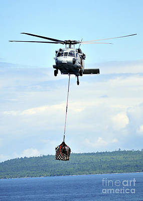 Netting Photograph - A Mh-60 Knighthawk Carries Supplies by Stocktrek Images