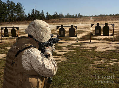 Firing Range Photograph - A Military Policeman Fires A Rifle by Stocktrek Images