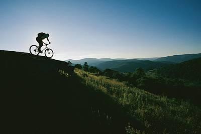 A Mountain Biker Heads Down A Hill Art Print