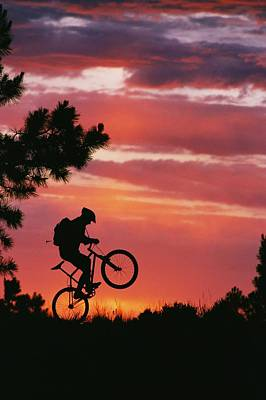Southwestern States Photograph - A Mountain Biker Is Silhouetted by David Edwards
