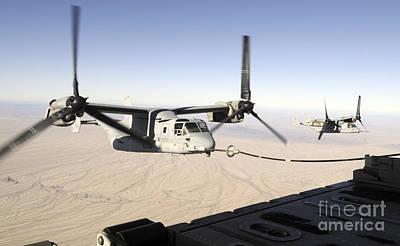 A Mv-22 Osprey Refuels Midflight While Art Print by Stocktrek Images
