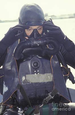 A Navy Seal Combat Swimmer Adjusts Art Print
