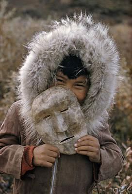 Impish Photograph - A Nunamiut Boy In A Fur-trimmed Parka by Thomas J Abercrombie