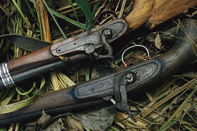 A Pair Of Old Flint-type Rifles Lying Art Print by Steve Winter