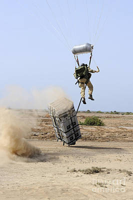 Floating Box Photograph - A Pararescueman Drops Into The Zone by Stocktrek Images