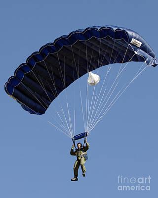 A Paratrooper Descends Through The Sky Art Print by Stocktrek Images
