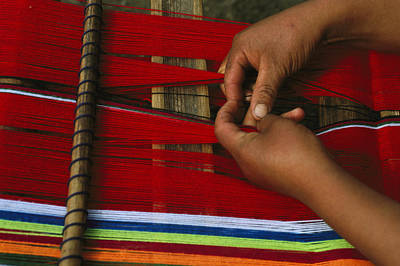 Hand-weaving Photograph - A Peruvian Woman Weaving With Colorful by Gordon Wiltsie