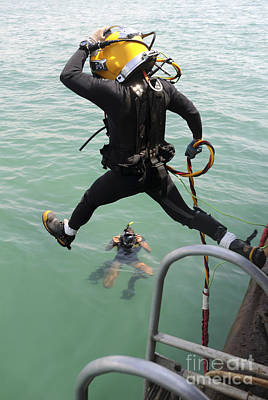 Videographer Photograph - A Photographer Documents A Navy Diver by Stocktrek Images