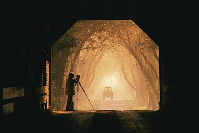 A Photographer Sets Up His Camera Print by Richard Nowitz