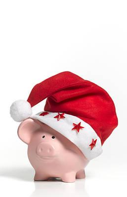A Piggy Bank Wearing A Santa Hat Art Print by Peter Dazeley
