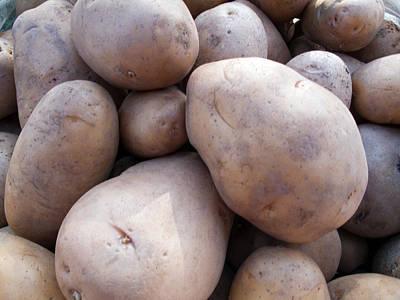 A Pile Of Large Lumpy Raw Potatoes Art Print by Ashish Agarwal
