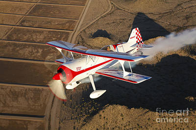 Photograph - A Pitts Model 12 Aircraft In Flight by Scott Germain