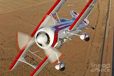 A Pitts Model 12 Biplane In Flight Art Print