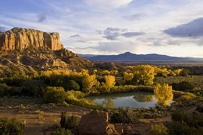 Abiquiu Photograph - A Pond Is Seen Next To Kitchen Mesa by Ralph Lee Hopkins